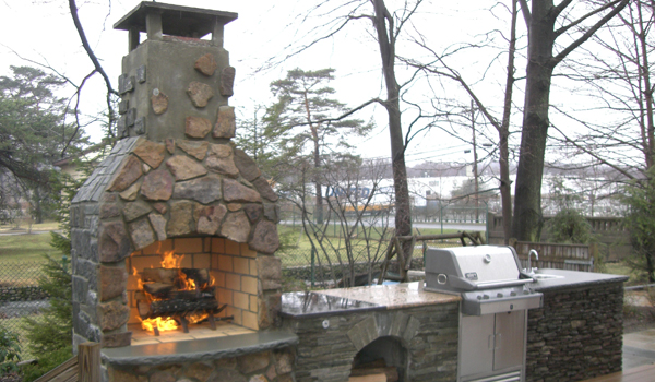 Landscape fireplace with fire roaring