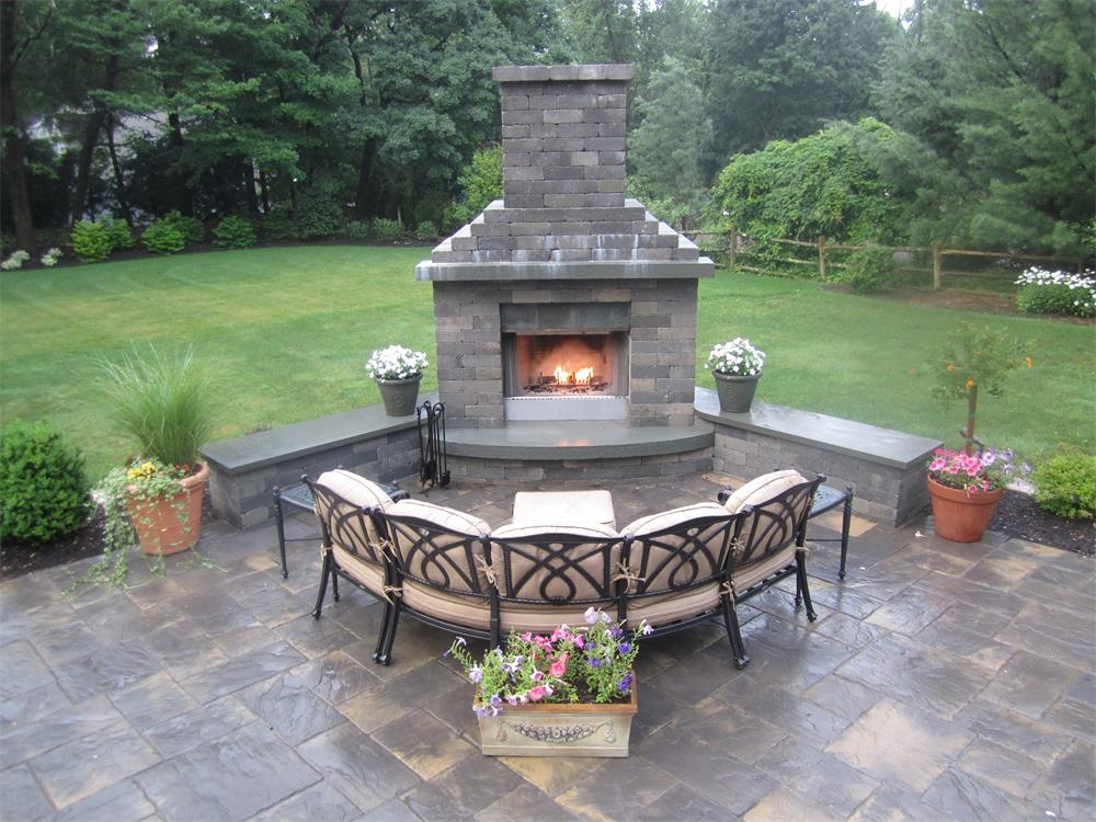 Outdoor fireplace and patio with benches