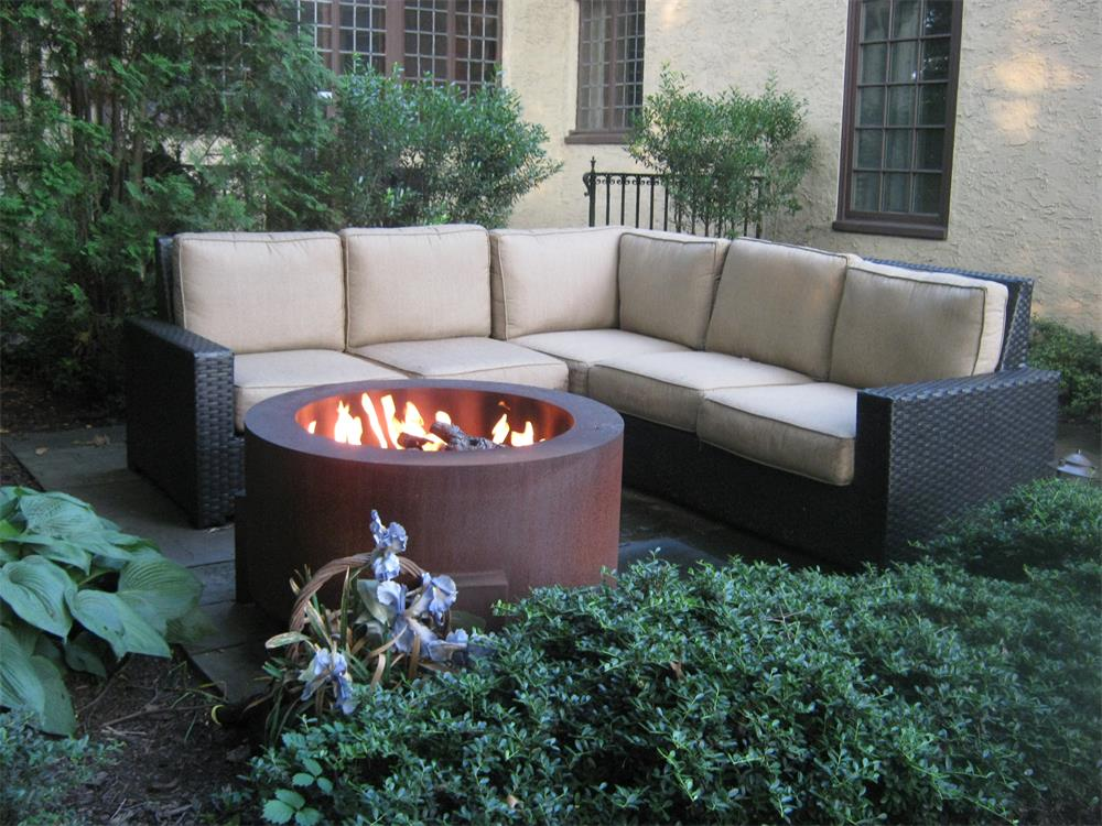 Cozy outdoor fireplace and seating area