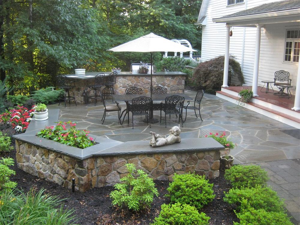 Patio dining area with landscape planting